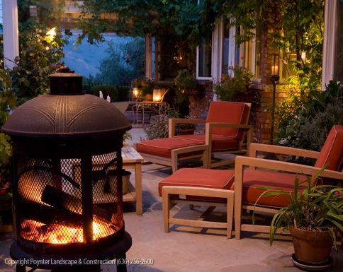 Covered back patio with lighting accents and outdoor living space poynter landscape architecture