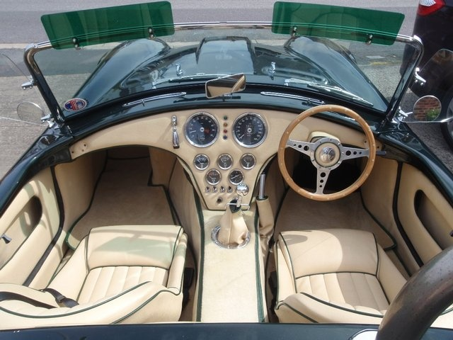"""A rare classic - a 1977 factory-built """"Libra Cobra"""" in racing green with beige interior. 3.0 litre V6 Essex engine, soft top, side screens, tonneau cover and factory built hard top."""