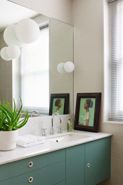 See all our stylish bathroom design ideas - including this bathroom belonging to Hugh Leslie, with Artemide 'Dioscuri' lights floating on the mirror.