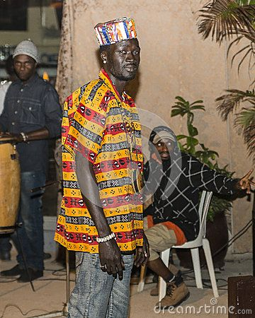 Model in the time of show dressed in colorful African clothes.  http://www.fashionghana.com/site/exclusive-pictures-of-on-gambia-fashion-show-with-tara-designs-starfit-phuzion/
