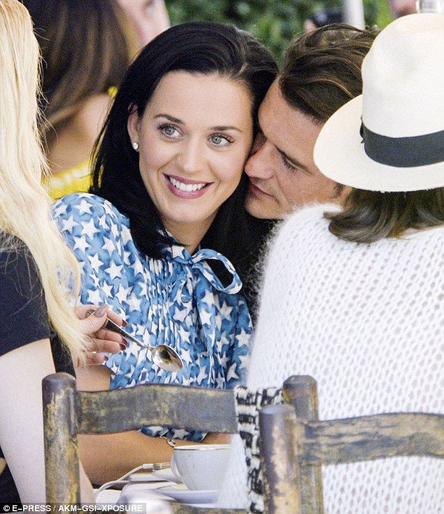 Kiss me quick! Katy Perry and boyfriend Orlando Bloom could barely keep their hands or lips off each other as they enjoyed an al fresco lunch in Cannes on Tuesday