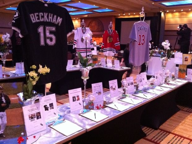 basic idea for silent auction set up with jerseys on display