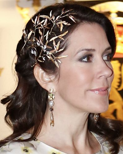 30 April 2016 - Princess Mary wears a gold headpiece by Ole Lynggaard at King Carl-Gustaf of Sweden's birthday dinner