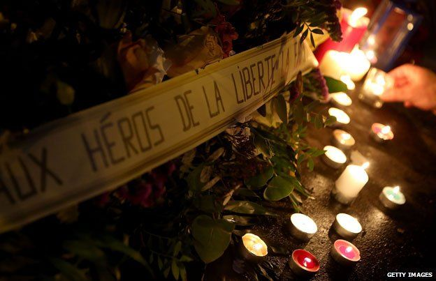 Flowers and candles laid close to the Charlie Hebdo offices.  Historian and writer Tom Holland was one of those who tweeted Charlie Hebdo's cartoon of the Prophet Muhammad in the wake of the deadly attack on the magazine's office. He explains why in an essay for the Magazine.