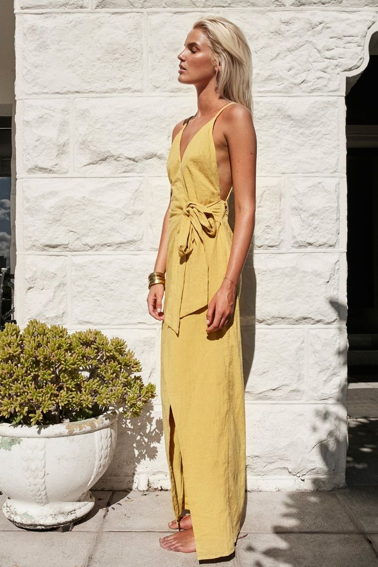 Low backs are everything! The Raw Citrus Wrap Maxi is made from a raw cotton fabric in a citrus hue. It is a wrap style maxi and features a super low back with gold eyelet detailing, a tie at side, thin double straps, and a crossover V neckline. Accessorise with statement gold earrings and your favourite pair of black or tan heels! By SABO LUXE.