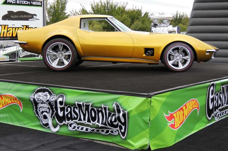 A perfect profile of the 1968 Gold Corvette atop a GMG platform.
