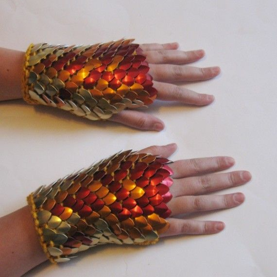 Dragonhide Gauntlets: the look of scale maille but with handknitted comfort, flexibility and warmth. The flame pattern of the scales on these