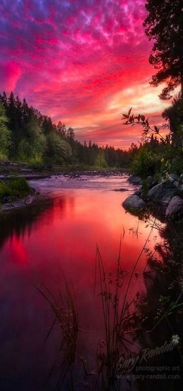 'Garnet Glow' ~ The sunset above the Sandy River near Mount Hood Oregon. The sunset was affected by the smoke in the sky from the Central Oregon forest fires.  by Gary Randall