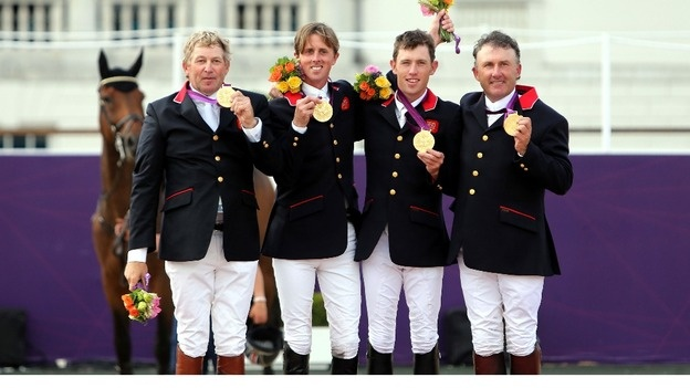 Team GB showjumpers get gold - Nick Skelton, Ben Maher, Scott Brash and Peter Charles celebrate with their Gold medals after the Equestrian Team Jumping.