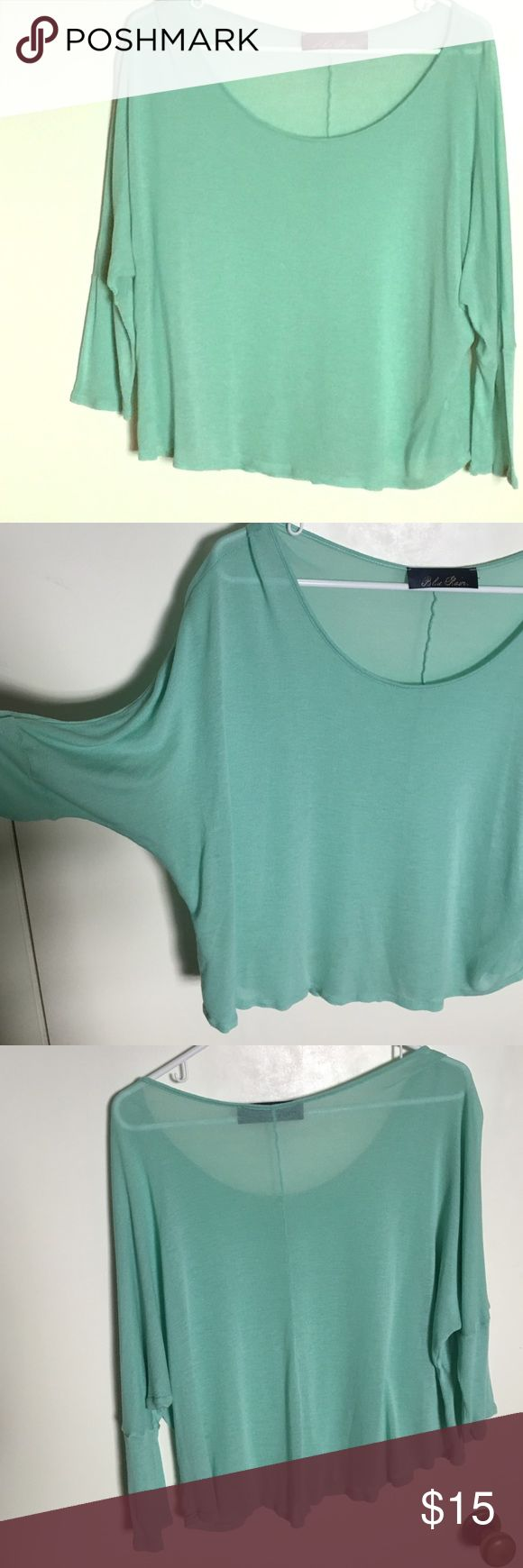 """Francesca's mint green long sleeved top Brand is """"blue rain"""" from Francesca's. Lightweight top hits at high waist with 3/4 length sleeves. Color is a beautiful mint green. I've only worn it once-it's just too short for me as I'm 5'11"""". No defects. Francesca's Collections Tops Tees - Long Sleeve"""