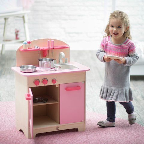 Hape pink gourmet kitchen with cookware included. Sold online in NZ www.directtoys.nz