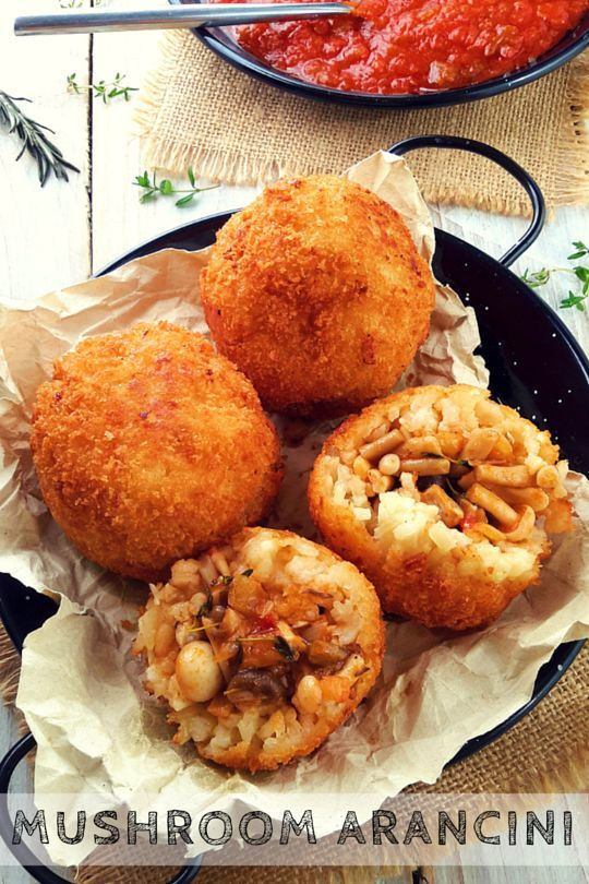 Mushroom-stuffed fried risotto balls.They look fancy-schmancy but they're easy to make. Makes a great vegan/vegetarian starter or main dish.