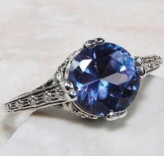 Alexandrite was the stone of Russian royalty. This beautiful vintage inspired ring lends itself to the original Alexandrites of old that were mined out of Russia until about 100 years ago (see Wiki li