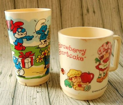Strawberry Shortcake and Smurf plastic cups.. I had these :)