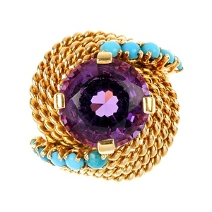 An amethyst and turquoise dress ring