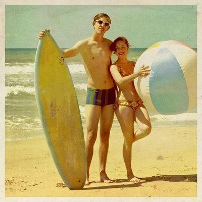 Surf board and a beach ball are great props for a vintage beach photo shoot