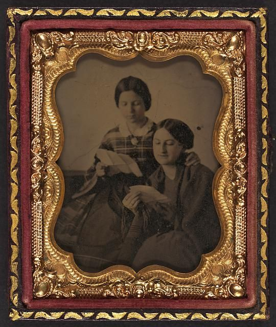[Two unidentified women reading letters]