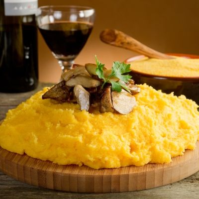 Mamaliga - National dish of Moldova. Yellow maize porridge served with sour cream and cheese or in hot milk.