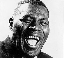 "Chester Arthur Burnett (June 10, 1910 – January 10, 1976), known as Howlin' Wolf, was an influential American blues singer, guitarist and harmonica player.    With a booming voice and looming physical presence, Burnett is commonly ranked among the leading performers in electric blues; musician and critic Cub Koda declared, ""no one could match Howlin' Wolf for the singular ability to rock the house down to the foundation while simultaneously scaring its patrons out of its wits.""["
