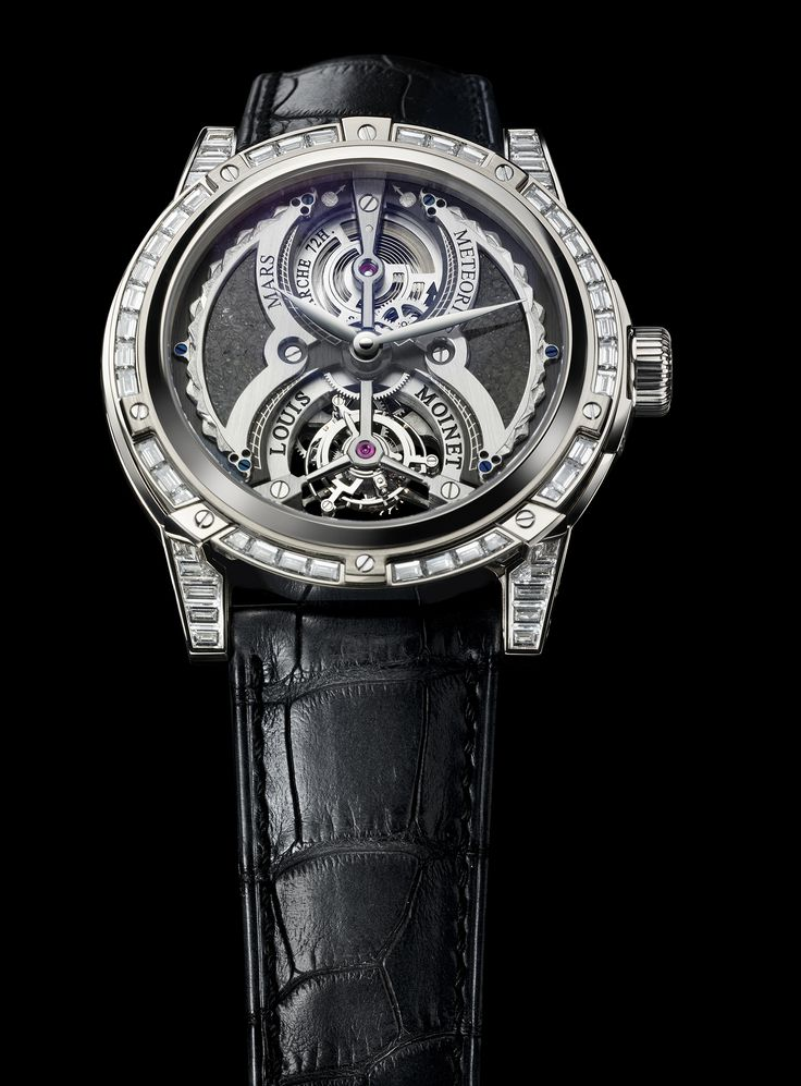 Tourbillon Mars with white gold case. Tourbillon Mars features a rotating tourbillon cage and its dial presents a hand-crafted fragment of the Jiddat al Harasis 479 meteorite, an authentic piece of the planet Mars that fell to Earth. For more information, please visit: http://www.louismoinet.com/collection-tourbillon-mars-p27.php