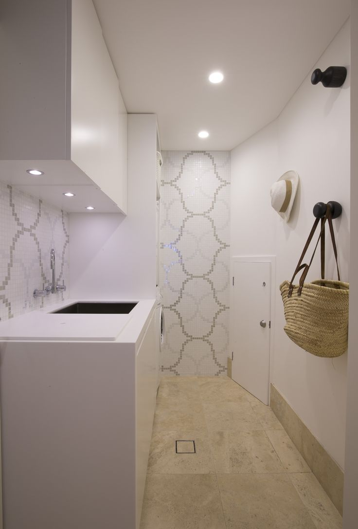 Laundry with sink cover panel. Brooke Aitken Design
