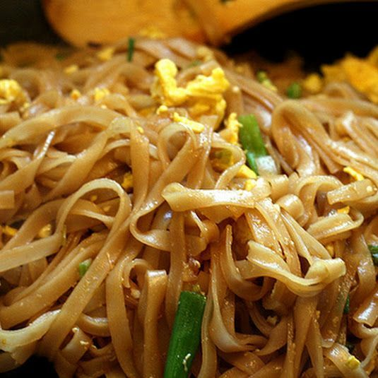 Easy Pad Thai Unlock Grocery List!  8  ounces dried, wide and flat rice noodles  2  tablespoons brown sugar  2  tablespoons fresh lime juice, plus wedges for serving  3  tablespoons soy sauce  1  squirt (about ⅛ teaspoon) Sriracha (optional)  2  teaspoons vegetable oil  3  scallions (green onions), white and green parts, separated and thinly sliced  1  garlic clove, minced  2  large eggs, light beaten (optional)  ½  cup fresh cilantro  ¼  cup chopped roasted, salted peanut