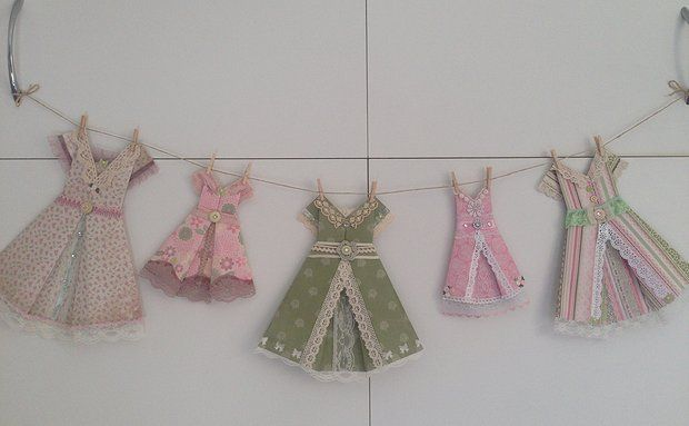 Can purchase on Etsy Handmade origami dresses - great gifts sold as individuals and in packages, come with rustic twine, miniature pegs for hanging and decoupaged self-adhesive pegs to mount 'clothesline' for display