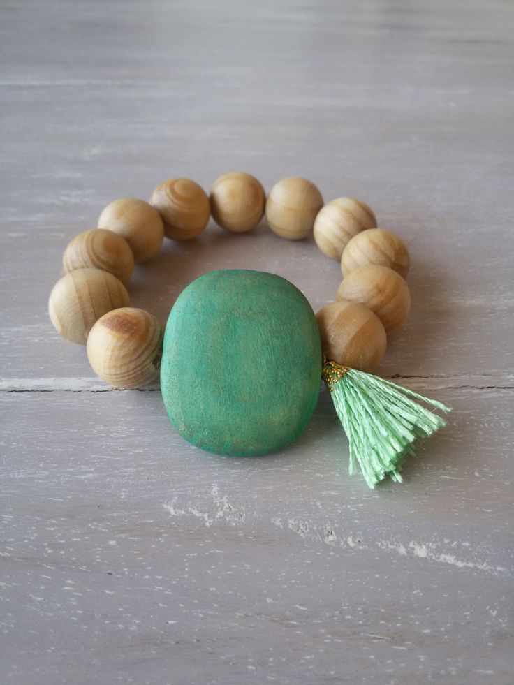 Natural wooden bead necklace with green tassel and big flat green wooden bead- elastic bracelet - stacking bracelet - boho bracelet by MerakibyStevie on Etsy