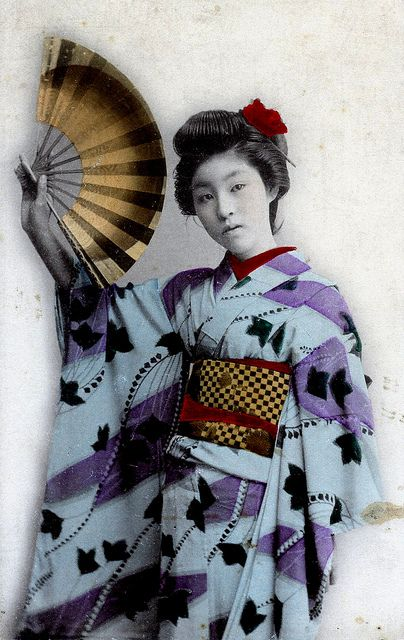 Maiogi 1910    A Maiogi is a dancing fan. This is quite a commonly reproduced image from around 1910. I think that she must be Hangyoku (Young Geisha) because of the long sleeves and highly patterned kimono. She doesn't look to be Maiko (Kyoto Apprentice).
