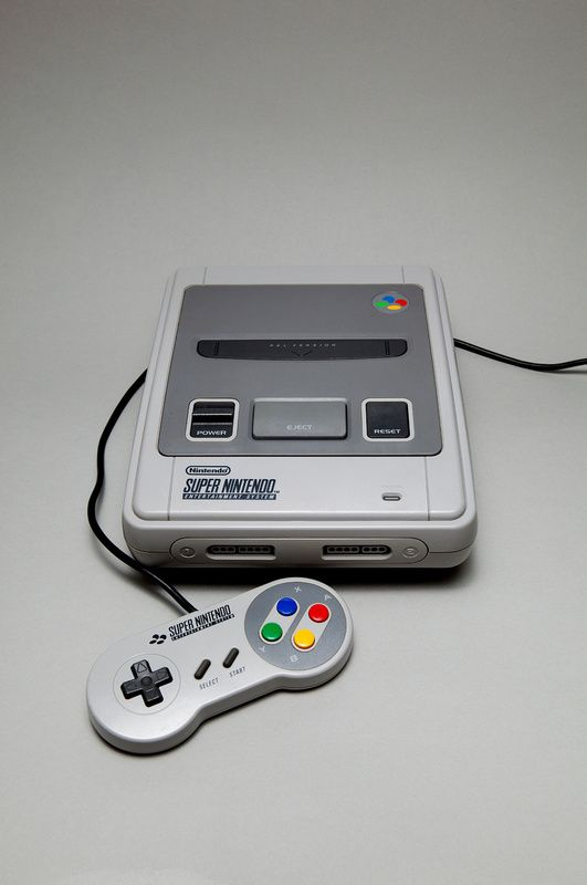 SNES - Great machine. Burnt the midnight oil so many times playing SF2 Turbo on this bad boy!