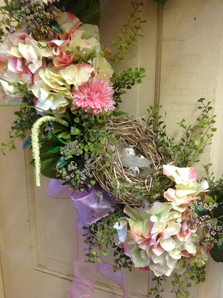 Close up view of birds nest on my wreath with a few eggs and feathers tucked in to the Nest.  So darling!