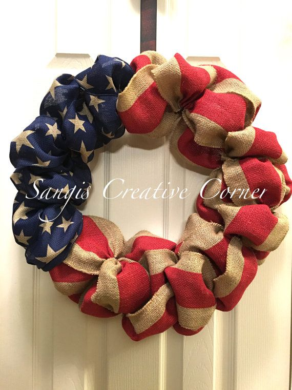 A classic burlap (Red/Natural Burlap with Patriotic stars wired ribbon) american flag wreath - red white and blue. This wreath is perfect