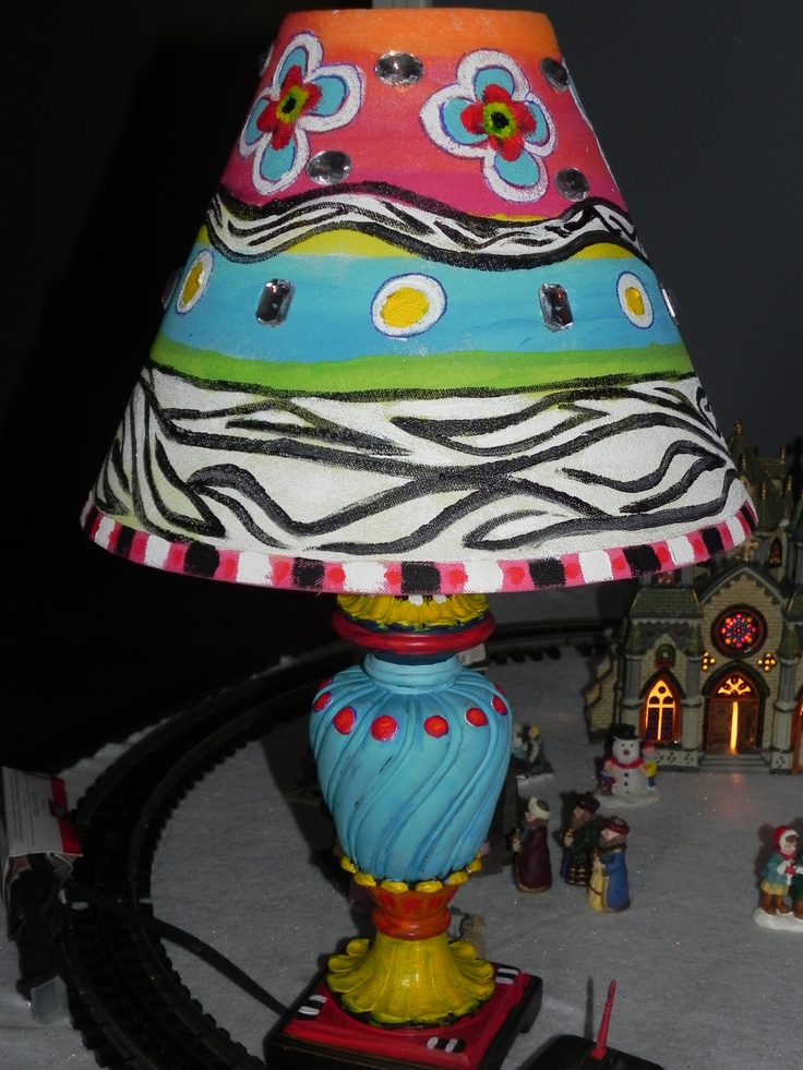 I added acrylic paint and bling to this very plain lamp ...