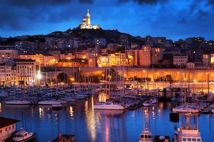 Vieux-Port of Marseille at dusk, with the Notre Dame de la Garde perched atop it http://www.nyhabitat.com/blog/2015/05/26/video-tour-marseille-part-1/