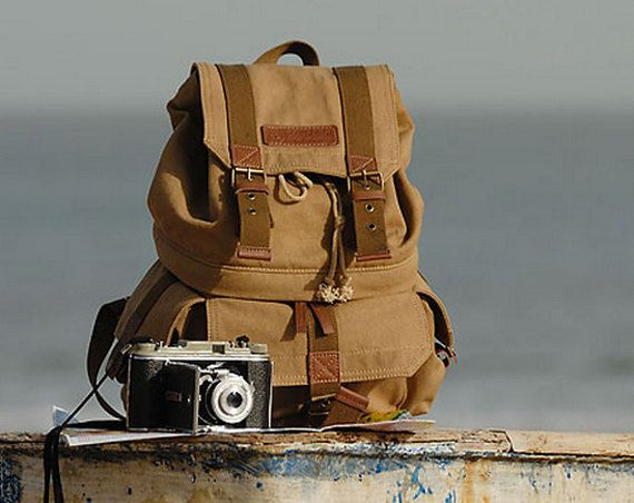 Love this canvas camera bag! https://www.etsy.com/listing/166925135/extra-large-canvas-dslr-camera-backpack