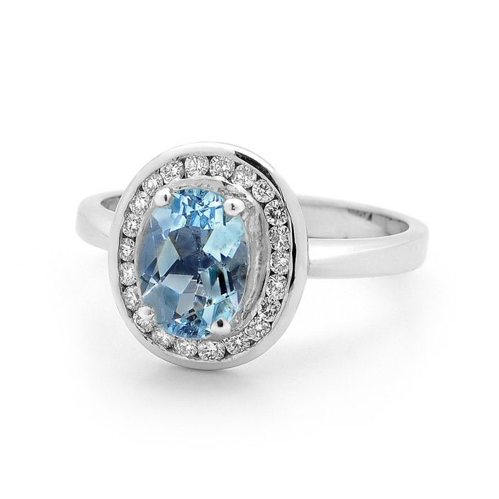 Wendy Manzo Jewellery. Ice Blue Topaz so reminiscent of aquamarines at their best, set in a cluster surrounded by a channel of brilliant cut small diamonds.