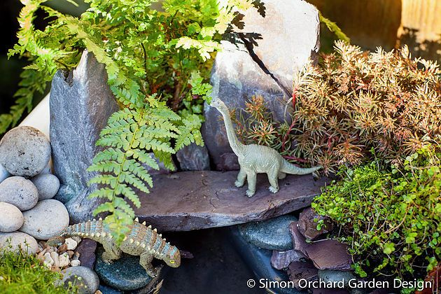 Create your own mini dinosaur garden. Hours of fun for little explorers! This miniature dinosaur park is easy to make from an old Belfast sink. Our blog shows you everything you need to make this tiny garden, including a list of plants. #miniaturegarden #dinosaurpark #minigarden #dinosaurgarden