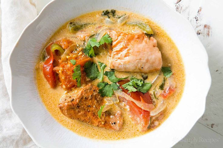 Brazilian salmon fish stew! Salmon cooked with tomatoes, bell peppers, onions, and coconut milk. So amazingly good! #paleo On SimplyRecipes.com