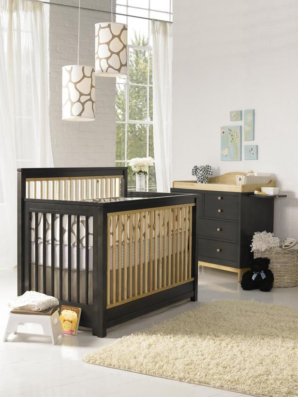To create a gender-neutral nursery both babies will love, animal print is the perfect theme. In this contemporary, organic nursery, the sleek crib stands out among the neutral palette and soft decor. The mix of black and seagrass wood stains helps to maintain a nice color balance within the space. | via HGTV