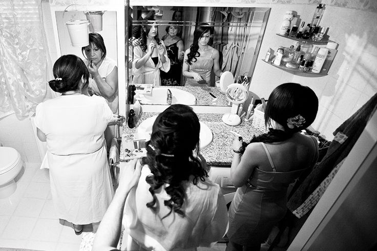 mother, bride and sister getting ready for the wedding day.
