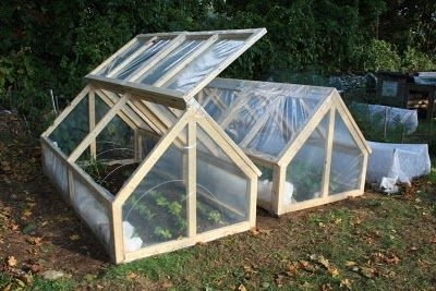Mini Greenhouse ideas for the home gardener. Love the double protection.