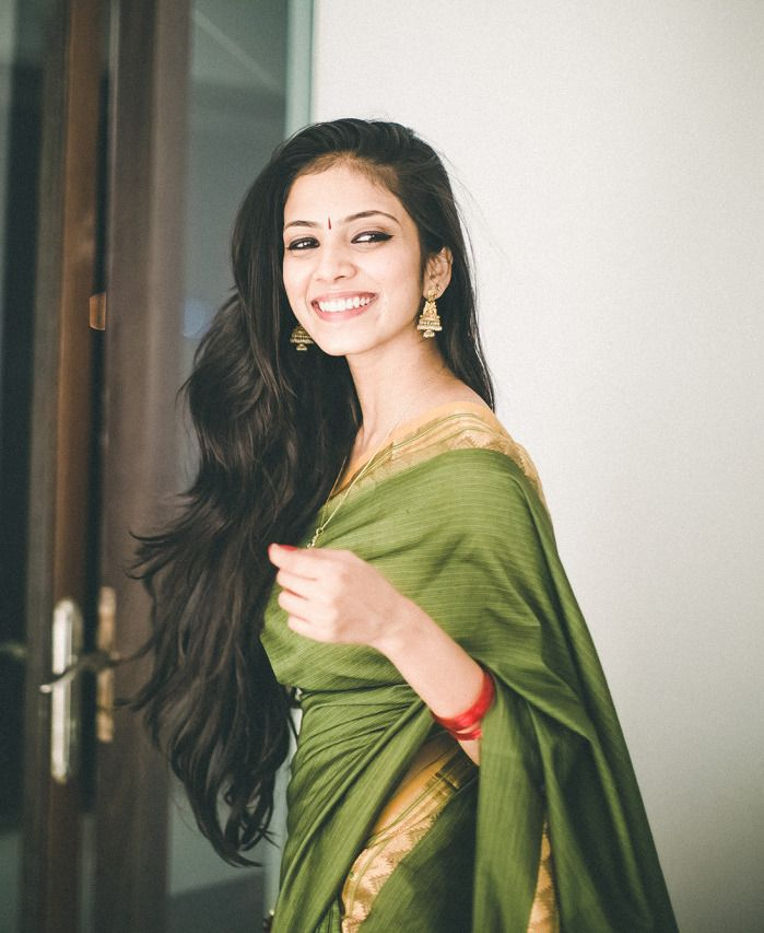 Love the saree,. her beautiful hair. lovely shot too.