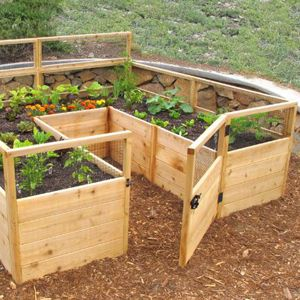 Create your own little garden sanctuary with one of these DIY raised garden kits! These easy-to-build kits have many benefits - they can keep pesky garden critters from eating your produce and save your back from bending over! #diy #raisedgarden #gardening