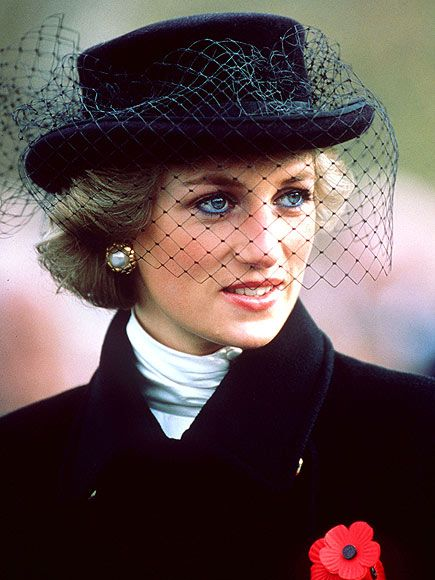 At an Armistice Day ceremony in 1988, Diana wore a solemn black hat and veil to review a parade honoring World War I Veterans on the Champs Elysees in Paris, an ironic foreshadowing of her tragic fate.: