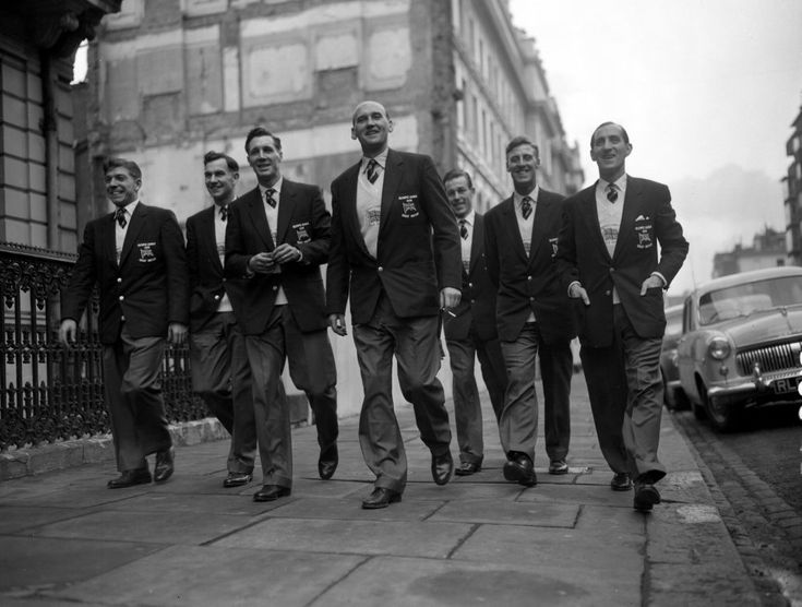The dapper gents of the 1956 British Olympic Soccer team off to Melbourne, Australia. Left to right Herbert Dodkins (Ilford); Derek Lewin (Bishop Auckland); James Lewis (Chelsea); Bob Hardisty (Bishop Auckland); Dexter Adams (Hendon); D Coates (Royal Navy) and John Laybourne (Corinthian Casuals).