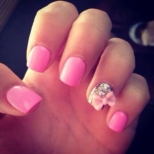 Hot pink nails, glitter and bow decal.