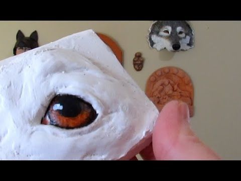 Painting Animal Eyes on Paper Mache Sculptures using acrylic paints.