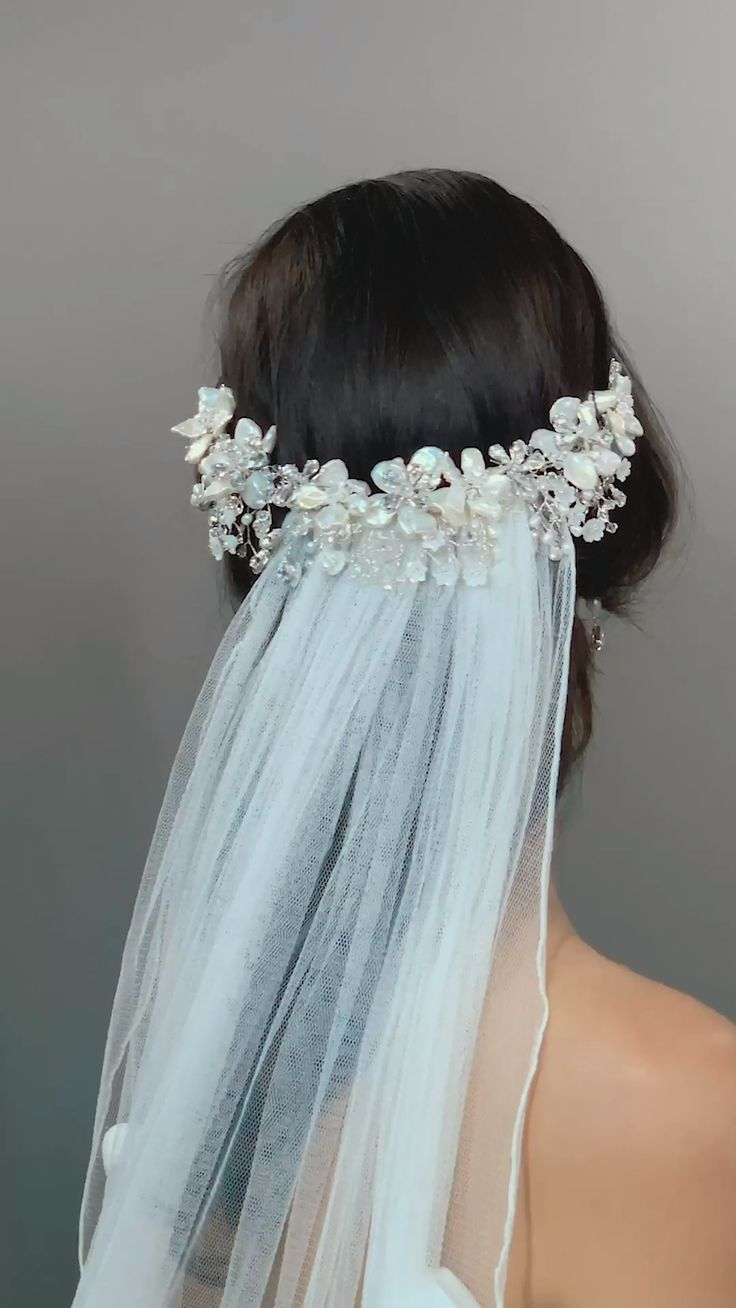 floral elegant whimsical crystal veil real bridal accessories inspiration wedding headdress. Pearl flowers embellished with glistening Swarovski crystals make for a gorgeous display in the hair.