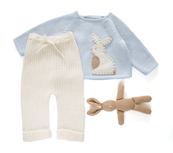 Knitted sweater and ribbed pants in soft blue and off white with a felt rabbit. 100% merino wool. READY TO SHIP in size Newborn. #babyknits #tenderblue