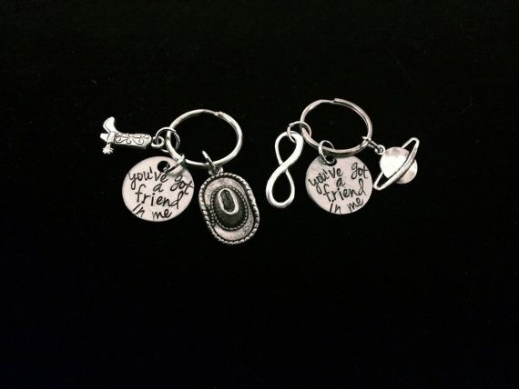 This is a SET of two keychains, both inspired by Toy Story. Each keychain comes with a silver charm engraved with the phrase youve got a friend in